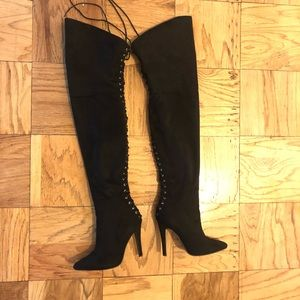 Black thigh high laced boots